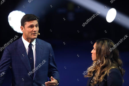Argentina former soccer Player Javier Zanetti, left, speaks during the draw for the 2019 Copa America soccer tournament in Rio de Janeiro, Brazil, . Brazil will host the continental soccer tournament in June and July