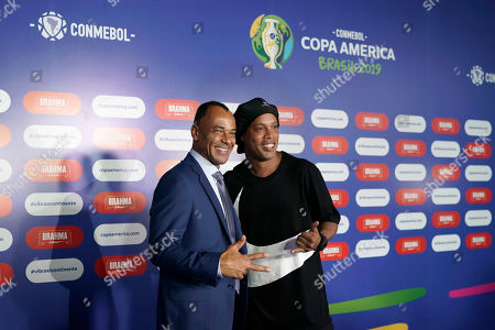 Brazil former soccer player Cafu, left, and Ronaldinho Gaucho pose for photos prior to the draw for the 2019 Copa America soccer tournament in Rio de Janeiro, Brazil, . Brazil will host the continental soccer tournament in June and July