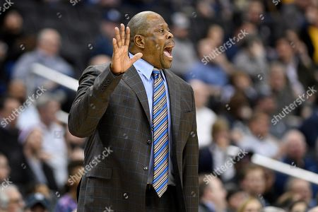 Georgetown head coach Patrick Ewing gestures during the first half of an NCAA college basketball game against Marquette, in Washington