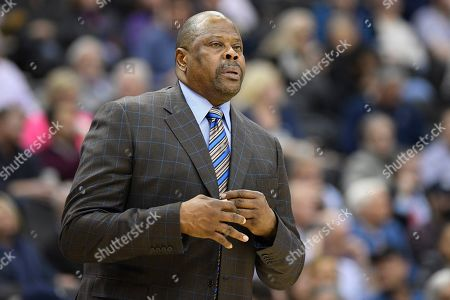 Georgetown head coach Patrick Ewing stands on the court during the first half of an NCAA college basketball game against Marquette, in Washington