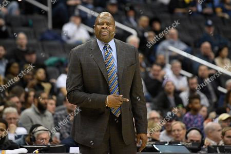 Georgetown head coach Patrick Ewing reacts during the first half of an NCAA college basketball game against Marquette, in Washington