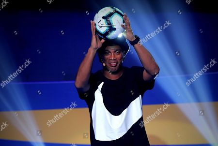 Former Brazilian soccer player Ronaldinho presents the official ball of the Copa America 2019, during the draw of Copa America Brazil 2019 in Rio de Janeiro, Brazil, 24 January 2019. The Copa America tournament will run from 14 June to 07 July 2019.