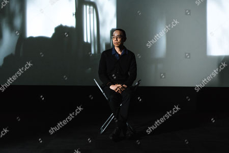 Apichatpong Weerasethakul with his artwork 'Invisibility'