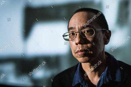 Stock Image of Apichatpong Weerasethakul with his artwork 'Invisibility'
