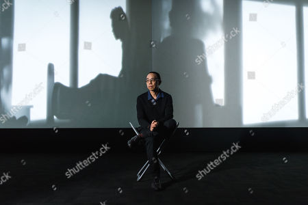 Stock Picture of Apichatpong Weerasethakul with his artwork 'Invisibility'
