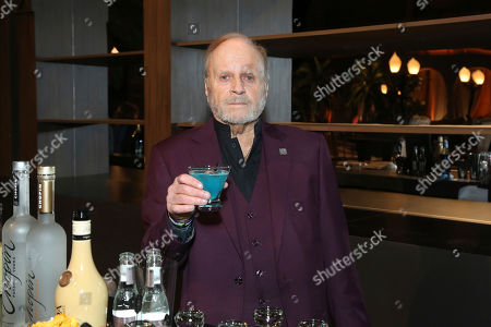 """Stock Image of President and CEO at The Blinn Group Ed Blinn toasts with a special cocktail that commemorates the 25th anniversary of the ceremony at the 25th Annual SAG Awards """"Cocktails with the SAG Awards"""" event at the Shrine Auditorium and Expo Hall, in Los Angeles"""