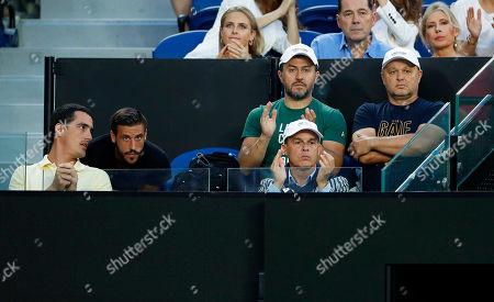 Marian Vajda (back R) of Slovakia, coach of Serbia's Novak Djokovic, attends the men's singles semi final match between Djokovic and Lucas Pouille of France at the Australian Open Grand Slam tennis tournament in Melbourne, Australia, 25 January 2019.