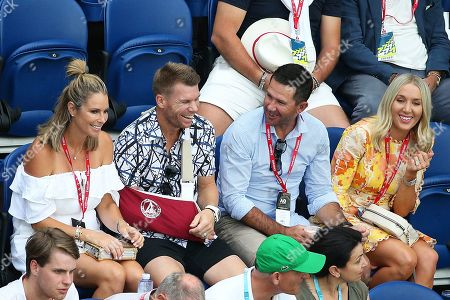 (L-R) Australian former professional ironwoman Candice Warner, Australian cricketer David Warner, Australian cricketer Ricky Ponting, and wife Rianna Jennifer Cantor attend the men's singles semi final match between Novak Djokovic of Serbia and Lucas Pouille of France at the Australian Open Grand Slam tennis tournament in Melbourne, Australia, 25 January 2019.