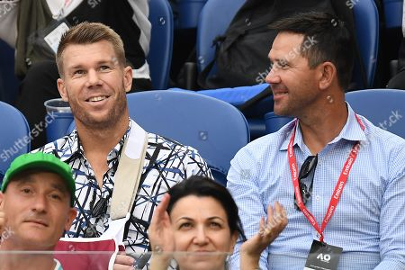 Australian cricketers David Warner (L) and Ricky Ponting (R) attend the men's singles semi final match between Novak Djokovic of Serbia and Lucas Pouille of France at the Australian Open Grand Slam tennis tournament in Melbourne, Australia, 25 January 2019.