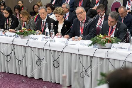 Swiss Federal Councillor Guy Parmelin (2-R) speaks next to WTO Director-General Roberto Azevedo (R) and Swiss state Secretary Marie-Gabrielle Ineichen-Fleisch (3-R) at the World Trade Organization (WTO) Informal ministerial gathering on the sideline of the last day of the 49th annual meeting of the World Economic Forum (WEF) in Davos, Switzerland, 25 January 2019. The meeting brings together entrepreneurs, scientists, corporate and political leaders in Davos under the topic 'Globalization 4.0' from 22 to 25 January 2019.
