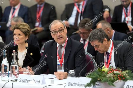 Swiss Federal Councillor Guy Parmelin (C) speaks next to WTO Director-General Roberto Azevedo (R) and Swiss state Secretary Marie-Gabrielle Ineichen-Fleisch (L) at the World Trade Organization (WTO) Informal ministerial gathering on the sideline of the last day of the 49th annual meeting of the World Economic Forum (WEF) in Davos, Switzerland, 25 January 2019. The meeting brings together entrepreneurs, scientists, corporate and political leaders in Davos under the topic 'Globalization 4.0' from 22 to 25 January 2019.