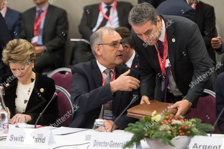 Swiss Federal Councillor Guy Parmelin (C) speaks with WTO Director-General Roberto Azevedo in front of Swiss state Secretary Marie-Gabrielle Ineichen-Fleisch (L) at the World Trade Organization (WTO) Informal ministerial gathering on the sideline of the last day of the 49th annual meeting of the World Economic Forum (WEF) in Davos, Switzerland, 25 January 2019. The meeting brings together entrepreneurs, scientists, corporate and political leaders in Davos under the topic 'Globalization 4.0' from 22 to 25 January 2019.