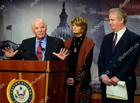 United States Senator Ben Cardin (Democrat of Maryland), left, US Senator Lisa Murkowski (Republican of Alaska), center, and US Senator Chris Van Hollen (Democrat of Maryland), right, conduct a press conference in the US Capitol in Washington, DC following the votes on