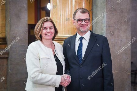 Finnish Prime Minister Juha Sipila (R) and Swedish International Development Cooperation and Climate and Deputy Prime Minister Isabella Lovin shake hands during their meeting in Helsinki, Finland, 25 January 2019. Finnish Prime Minister Juha Sipila and the Minister of Environment, Energy and Housing Kimmo Tiilikainen have invited Prime Ministers and Climate Ministers from the Nordic countries to Helsinki on 25 January to strengthen the joint Nordic action on climate change.
