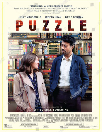 Stock Picture of Puzzle (2018) Poster Art. Kelly Macdonald as Agnes and Irrfan Khan as Robert