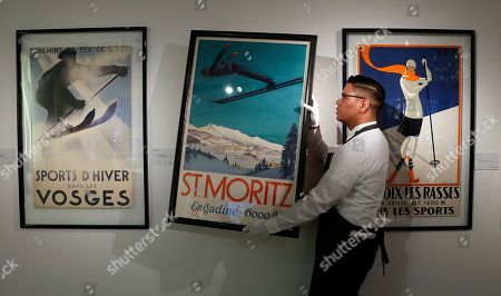 6291abe06f95 A Christie s employee moves the skiing poster St. Moritz by Carl Moos at  Christie s auction