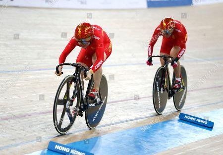 Lin Junhong, Zhong Tianshi. Team China Lin Junhong, front, and teammate Zhong Tianshi competes during Women's Team Sprint Finals at the World Track Cycling championships in Hong Kong