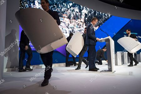 Workers carry podiums off stage, with Borge Brende, WEF President, center, prior the closing plenary session in the Congress Hall at the 49th annual meeting of the World Economic Forum (WEF) in Davos, Switzerland, 25 January 2019. The meeting brings together entrepreneurs, scientists, corporate and political leaders in Davos under the topic 'Globalization 4.0' from 22 to 25 January 2019.