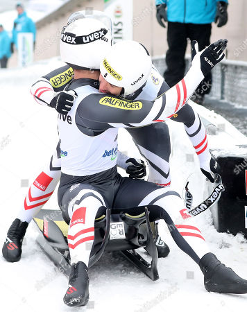 Thomas Steu and Lorenz Koller of Austria celebrate in the finish area after placing third the men's competition of the Luge World Championships Sprint Doubles Race in Winterberg, Germany, 25 January 2019.