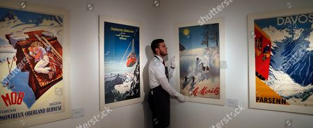 44e21d3bfb52 A Christie s employee adjusts skiing posters at Christie s auction house in  London