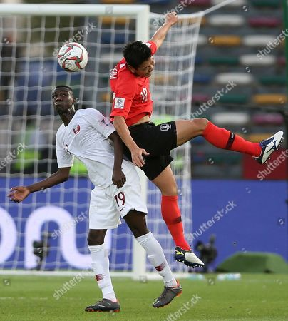 Qatar's forward Almoez Ali, left, fights for the ball with South Korea's defender Kim Young-Gwon during the AFC Asian Cup quarterfinal soccer match between Korea Republic and Qatar at the Zayed Sport City Stadium in Abu Dhabi, United Arab Emirates