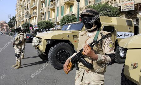 Stock Picture of Egyptian security forces stand guard in Tahrir Square, Cairo, Egypt, 25 January 2019 on the eighth anniversary of the uprising that toppled former President Hosni Mubarak. More than 800 people were killed and thousands injured during the 18-day uprising against the Egyptian regime which led to the removal of President Hosni Mubarak on 11 February 2011.