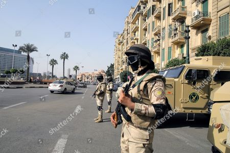 Stock Photo of Egyptian security forces stand guard in Tahrir Square, Cairo, Egypt, 25 January 2019 on the eighth anniversary of the uprising that toppled former President Hosni Mubarak. More than 800 people were killed and thousands injured during the 18-day uprising against the Egyptian regime which led to the removal of President Hosni Mubarak on 11 February 2011.