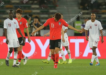 South Korea's midfielder Koo Ja-Cheol, center, reacts after his team lost the game against Qatar, during the AFC Asian Cup quarterfinal soccer match between Korea Republic and Qatar at the Zayed Sport City Stadium in Abu Dhabi, United Arab Emirates, . Qatar win the game 1-0