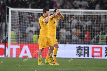 Stock Image of Australia's midfielder Christopher Ikonomid and Australia's midfielder Robbie Kruse hold their heads after losing 1-0 to United Arab Emirates during the AFC Asian Cup quarterfinal soccer match at Hazza Bin Zayed Stadium in Al Ain, United Arab Emirates