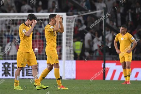 Australia's midfielder Christopher Ikonomid and Australia's midfielder Robbie Kruse hold their heads after losing 1-0 to United Arab Emirates during the AFC Asian Cup quarterfinal soccer match at Hazza Bin Zayed Stadium in Al Ain, United Arab Emirates