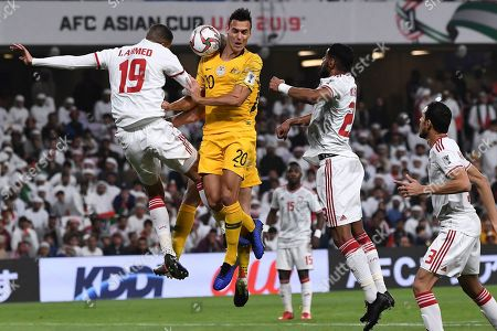 United Arab Emirates' defender Ismail Ahmed, left, jumps for the ball with Australia's defender Trent Sainsbury, centre, and United Arab Emirates' defender Mohamed Ahmad, right, during the AFC Asian Cup quarterfinal soccer match between United Arab Emirates and Australia at Hazza Bin Zayed Stadium in Al Ain, United Arab Emirates