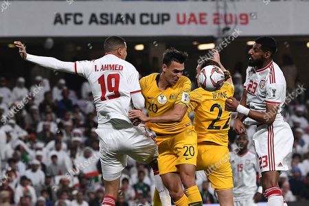 Stock Image of United Arab Emirates' defender Ismail Ahmed, left, jumps for the ball with Australia's defender Trent Sainsbury, centre, and United Arab Emirates' defender Mohamed Ahmad, right, during the AFC Asian Cup quarterfinal soccer match between United Arab Emirates and Australia at Hazza Bin Zayed Stadium in Al Ain, United Arab Emirates