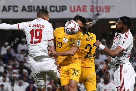Stock Photo of United Arab Emirates' defender Ismail Ahmed, left, jumps for the ball with Australia's defender Trent Sainsbury, centre, and United Arab Emirates' defender Mohamed Ahmad, right, during the AFC Asian Cup quarterfinal soccer match between United Arab Emirates and Australia at Hazza Bin Zayed Stadium in Al Ain, United Arab Emirates