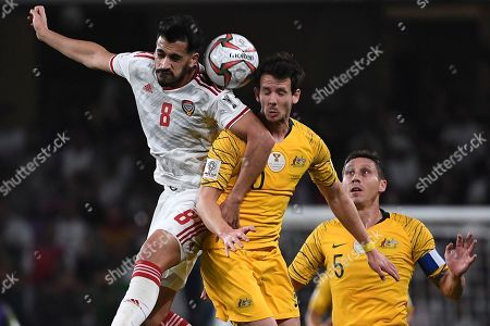United Arab Emirates' midfielder Made Hassan, left, jumps for the ball with Australia's midfielder Robbie Kruse during the AFC Asian Cup quarterfinal soccer match between United Arab Emirates and Australia at Hazza Bin Zayed Stadium in Al Ain, United Arab Emirates