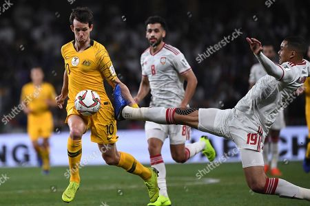 Australia's midfielder Robbie Kruse, left, control the ball past United Arab Emirates' defender Ismail Ahmed, right, during the AFC Asian Cup quarterfinal soccer match between United Arab Emirates and Australia at Hazza Bin Zayed Stadium in Al Ain, United Arab Emirates