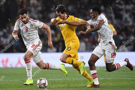 Australia's midfielder Robbie Kruse,centre, controls the ball between United Arab Emirates' midfielder Made Hassan, left, and United Arab Emirates' defender Khalifa Mubarak, right, during the AFC Asian Cup quarterfinal soccer match between United Arab Emirates and Australia at Hazza Bin Zayed Stadium in Al Ain, United Arab Emirates