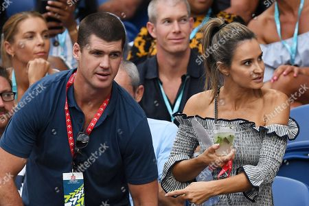Former professional Australian rules footballer Jonathan Brown and wife, Kylie, are seen in the crowd during the men's singles semifinal match of the Australian Open tennis tournament in Melbourne, Australia, 25 January 2019.