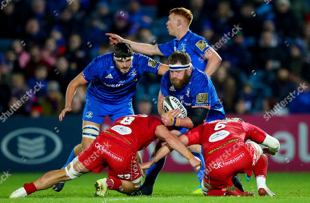 Leinster vs Scarlets. Leinster's Michael Bent with Josh Macleod and Tom Price of Scarlets