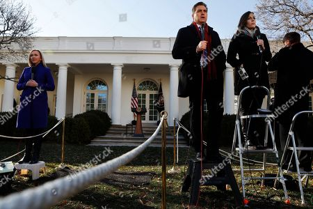 Paula Reed, Jim Acosta, Hallie Jackson, Sarah Huckabee Sanders. Television correspondents Paula Reed, CBS, left, Jim Acosta, CNN, and Hallie Jackson, NBC, report from the Rose Garden of the White House after President Donald Trump announced a deal to temporarily reopen the government, in Washington