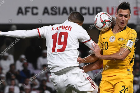 United Arab Emirates' defender Ismail Ahmed, left, fights for the ball with Australia's defender Trent Sainsbury during the AFC Asian Cup quarterfinal soccer match between United Arab Emirates and Australia at Hazza Bin Zayed Stadium in Al Ain, United Arab Emirates