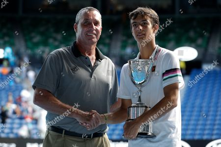 Italy's Lorenzo Musetti is congratulated by Ivan Lendl, left, after defeating United States' Emilio Nava in the boy's singles final at the Australian Open tennis championships in Melbourne, Australia