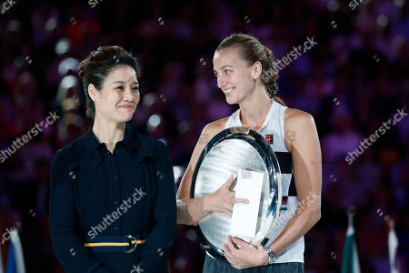 Petra Kvitova (R) of Czech Republic receives her runners up trophy from Li Na (L) of China after being defeated in her women's singles final match against Naomi Osaka of Japan at the Australian Open Grand Slam tennis tournament in Melbourne, Australia, 26 January 2019.