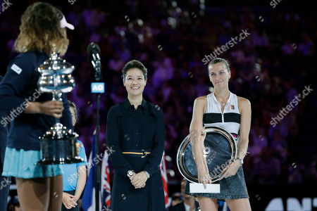 Petra Kvitova (R) of Czech Republic receives her runners up trophy from Li Na (C) of China after being defeated in her women's singles final match against Naomi Osaka (L) of Japan at the Australian Open Grand Slam tennis tournament in Melbourne, Australia, 26 January 2019.