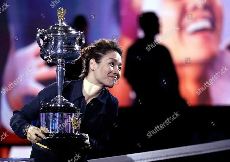 China's Li Na holds the Daphne Akhurst Memorial Cup prior to the start of the women's singles final at the Australian Open tennis championships in Melbourne, Australia
