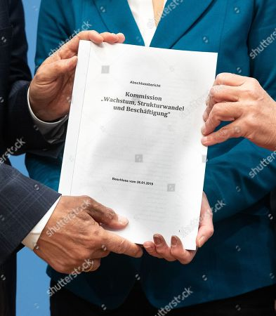 Stock Picture of (L-R) Chairpersons of the Coal Commission Stanislaw Tillich, Barbara Praetorius and Ronald Pofalla hold the final report of the Coal Commission 'Growth, structural change and employment' during a press conference in Berlin, Germany, 26 January 2019. A government-appointed Coal Commission has agreed that Germany should phase out all coal-fired power plants by the end of 2038.