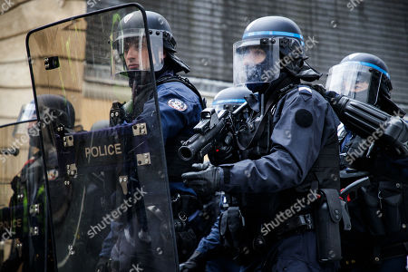 Stock Image Of A French Police Officer Holds LDB 40 Flashball Non