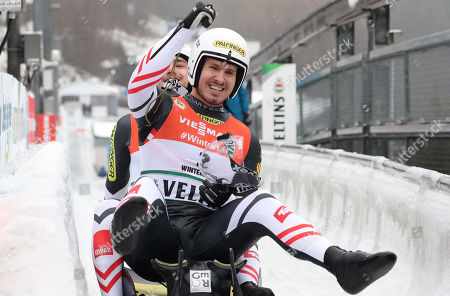 Thomas Steu and Lorenz Koller of Austria celebrate the second place in the finish area after the men's final run of the Luge World Championships Doubles Race in Winterberg, Germany, 26 January 2019.