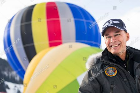 Swiss balloonist Bertrand Piccard, the first to succeed a non-stop flight around the world in hot air balloons with the Breitling Orbiter 3, smiles during the 41st International Hot Air Balloon Festival in the skiing resort of Chateau d'Oex, in the Swiss Alps, 26 January 2019. Seventy balloons from 15 countries are taking part in the event held in the Swiss mountain resort from 26 January to 03 February.