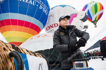 Swiss balloonist Bertrand Piccard, the first to succeed a non-stop flight around the world in hot air balloons with the Breitling Orbiter 3, reacts in front of a copy of the Orbiter 3, prior to take off during the 41st International Hot Air Balloon Festival in the skiing resort of Chateau d'Oex, in the Swiss Alps, 26 January 2019. Seventy balloons from 15 countries are taking part in the event held in the Swiss mountain resort from 26 January to 03 February.
