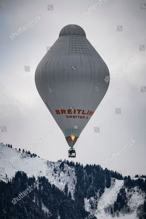 Swiss balloonist Bertrand Piccard and British balloonist Brian Jones, the first to succeed a non-stop flight around the world in hot air balloons with the Breitling Orbiter 3, take off with a copy of the Orbiter 3 during the 41st International Hot Air Balloon Festival in the skiing resort of Chateau d'Oex, in the Swiss Alps, 26 January 2019. Seventy balloons from 15 countries are taking part in the event held in the Swiss mountain resort from 26 January to 03 February.